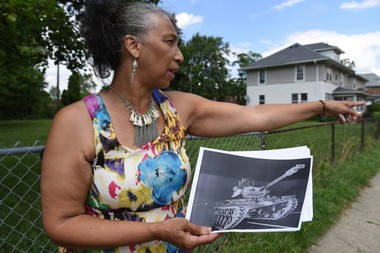 Venita Thompkins, 53 of Detroit, points to where a tank was parked on her street during the riots of 1967.