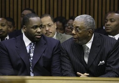 In this Oct. 28, 2008 file photo, former Detroit Mayor Kwame Kilpatrick, left, talks with his father Bernard, right, at his sentencing hearing in Detroit. Federal prosecutors in Detroit said Wednesday, Dec. 15, 2010 that they have filed new corruption charges against imprisoned ex-Mayor Kwame Kilpatrick and also are charging his father, Bernard Kilpatrick.