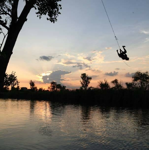 Zachary Zduniak on the now nonexistent rope swing at Belle Isle, photo by Mark Tucker