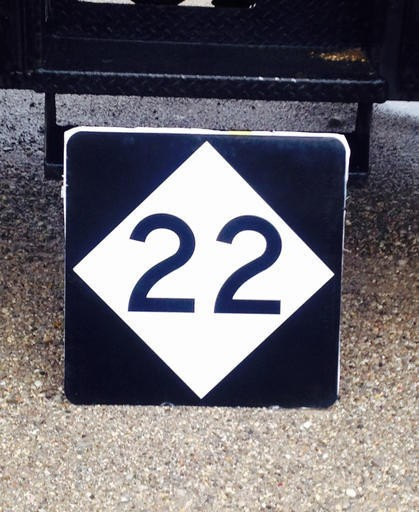"""This undated photo provided by the Michigan Department of Transportation shows a highway sign being installed that says """"22,"""" instead of M-22 signs that have been stolen. M-22 is known as an iconic highway in northern Lower Peninsula. Officials hope the new """"22"""" signs won't be appealing to thieves. (Michigan Department of Transportation via AP)"""