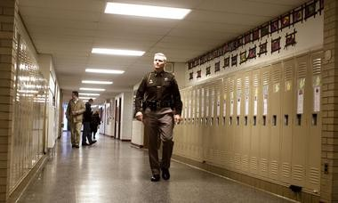 Muskegon County Sheriff's Capt. Michael Poulin evaluates a lockdown drill at Holton Elementary School. Poulin, president of North Muskegon Public Schools, did not know his district had not done similar drills.
