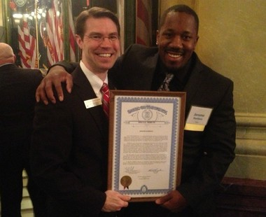 Former NFL running back Jerome Harrison and state Rep. Sean McCann at the Michigan Capitol on April 25, 2013.