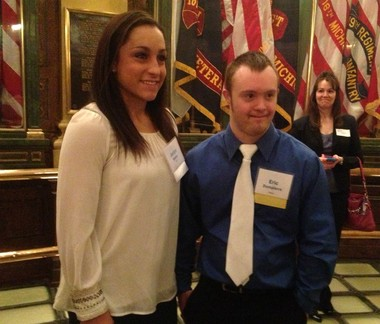 Eric Dompierre, right, poses for a photograph with Olympian Jordyn Wieber at the Michigan Capitol on April 25, 2013.