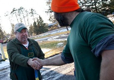 Jeff Powell, right, is congratulated by DNR wildlife assistant Kurt Hogue at the Wakefield DNR station after Powell successfully hunted a wolf Friday, Nov. 15, 2013. The wolf was the second recorded kill in the Michigan's first wolf hunt.