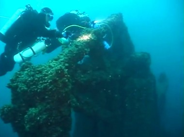 Divers explore the wreck of the Keystone State, a sidewheel steamer that sunk in Lake Huron in Nov. 1861. The wreck was found by David Trotter's team in July 2013.