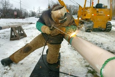 InfraSource Underground Construction employee Oren Diehl welds a joint of 6-inch diameter natural gas transmission line in an assembly area in Van Bragt Park in 2005.