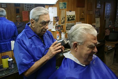 """Negaunee barber Paul Remillard says """"everybody would move out"""" if the mines close. (Photo by Ted Roelofs)"""