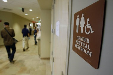 In this Aug. 23, 2007 file photo, a sign marks the entrance to a gender neutral restroom at the University of Vermont in Burlington, Vt. In clashes over transgender students and which restrooms and locker rooms they should use, the U.S. Department of Education has warned public schools that a sex discrimination law makes it illegal to deny them access to the facilities of their choice. (AP Photo/Toby Talbot, File) (Toby Talbot)