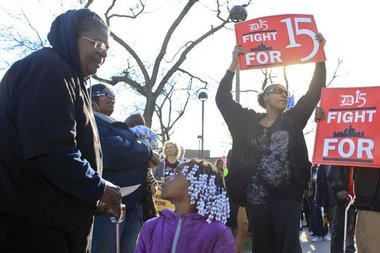 From left, Flint resident Lanette Simpson talks to her granddaughter Sariya, 5, next to Alisha Reed and Angelica Criswell of Detroit during a march in Midtown Detroit on Wednesday, April 15, 2015 to rally for $15 minimum wage. (Elaine Cromie | MLive Detroit)