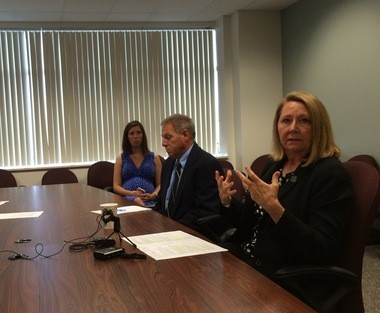 Michigan Department of Environmental Quality Director Heidi Grether, right, speaks to reporters Friday, Aug. 12, 2016.