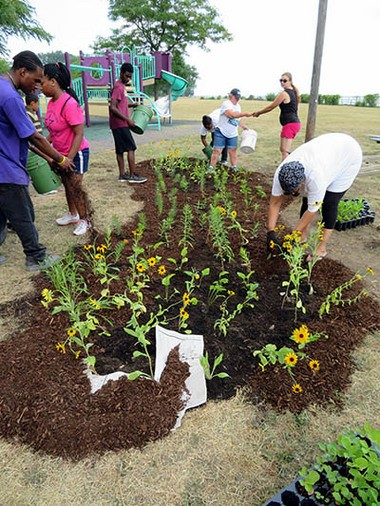 Volunteers construct a rain garden in Detroit earlier this summer at A.B. Ford Park not far from the Detroit River. (Photo courtesy city of Detroit)