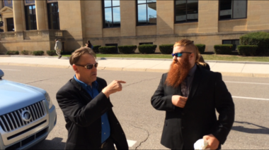 Jamie Lowell, a board member of MI Legalize, left, and plaintiff Dakota Blue Serna head into federal court for a Sept. 13 hearing regarding a vote to legalize marijuana in Michigan. The judge denied a motion to halt Michigan ballot printing and allow signatures to be counted to place the marijuana vote on the ballot.