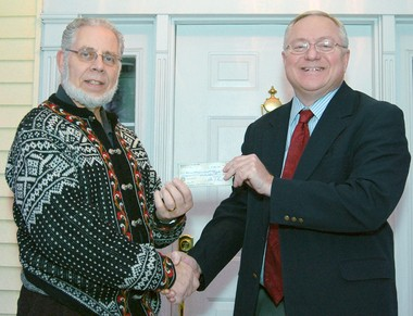 Sen. Rick Jones (right) presents a check from the Mid Michigan Future Fund to Rev. Bill Amundsen, treasurer of The Michigan Council on Alcohol Problems, in 2012. The Mid Michigan Future Fund is a nonprofit that has taken corporate donations.