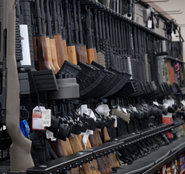 A variety of rifles on display at a gun shop outside of Detroit. Several of the guns have features that would be regulated under the proposed bill, including a pistol grip behind the trigger on a rifle.