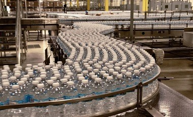 Ice Mountain brand bottled water on the packaging line at the Nestle Waters North America factory in Stanwood, Mich., on Wednesday, Nov. 30, 2016.