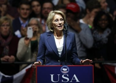 FILE - In this Dec. 9, 2016, file photo, Betsy DeVos, selected for Education Secretary by President-elect Donald Trump speaks during a rally, in Grand Rapids, Mich. (AP Photo/Paul Sancya, File)
