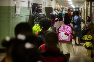 A student walks the hallway with a Hello Kitty backpack during the first day of school at Pierce Elementary School on Tuesday, Sept. 8, 2015 in Flint. Jake May | MLive.com