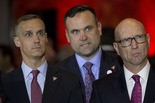 Republican presidential candidate Donald Trump Campaign Manager Corey Lewandowski, left, Dan Scavino, center, and Michael Glassner, watch as Ted Cruz gives his withdrawal speech during a primary night news conference, Tuesday, May 3, 2016, in New York. (AP Photo/Mary Altaffer)