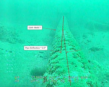Screenshot of the west leg of Enbridge Line 5 under the Straits of Mackinac that appears to show an area of bent pipe. Image from a June 2016 inspection.