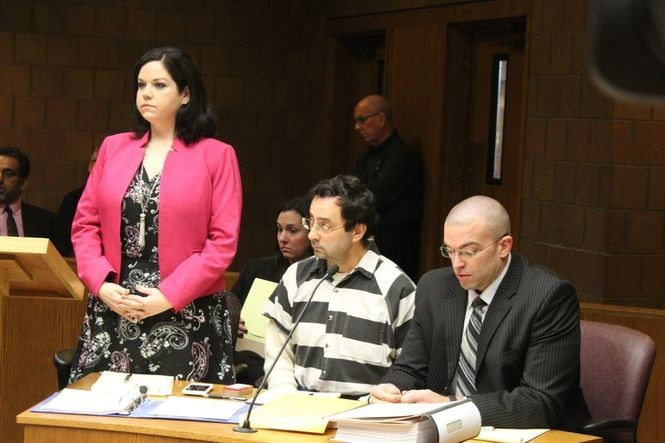 Shannon Smith, left, representing ex-MSU Dr. Larry Nassar, center, during a Feb. 17, 2017 hearing.