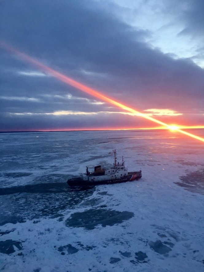 The Coast Guard Cutter Biscayne Bay, a 140-foot ice breaking tug home-ported in St. Ignance, Michigan, sails across Lake Michigan, Feb. 10, 2017. (U.S. Coast Guard photo courtesy by Air Station Traverse City)