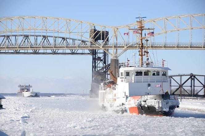 f46da72c36 Icy photos show Coast Guard, freighters pushing through Great Lakes freeze