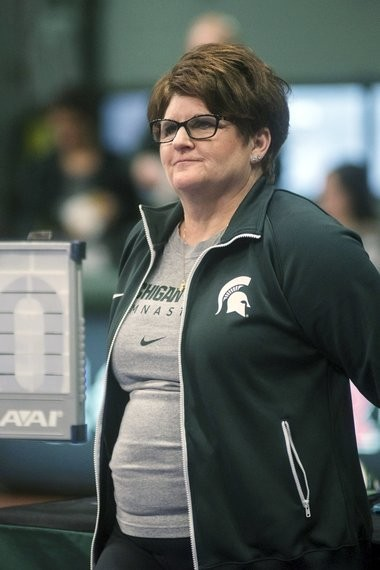 In this Feb. 13, 2015, file photo, Michigan State University gymnastics head coach Kathie Klages watches the team during a meet in East Lansing, Mich. (Emily Nagle/The State News via AP, File)