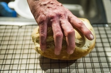 Ian Hartley prepares a loaf of homemade bread Feb. 26, 2018 in Redford. (Jake May | MLive.com)