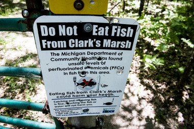A sign warns people not to eat the fish before entering Clark's Marsh on June 6, 2018 in Oscoda. High PFAS levels have been detected in Van Etten Lake, Clark's Marsh and the Au Sable River. (Jake May | MLive.com)