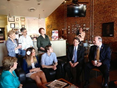 U.S. Rep. Dan Kildee, D-Flint Twp., (far right) endorses U.S. Rep. Gary Peters, D-Bloomfield Twp., (second from the right) for U.S. Senate Thursday at Brown Sugar Cafe in downtown Flint.