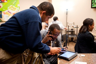 Kyle McCree of Flint gives councilman Delrico Loyd of Flint results of the police and jail millages while at 501 Bar and Grill in Flint in 2011 as Loyd passes the results on to councilman Dale Weighill.