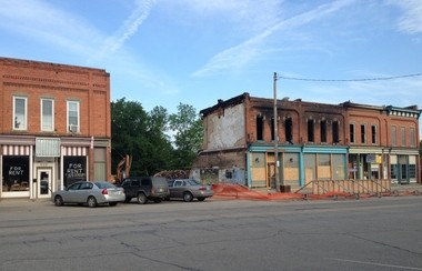 The owner of a Byron restaurant, Janelle's Family Restaurant, is suing a Wisconsin insurance company after the company allegedly denied covering a claim from an October 2012 fire. Law enforcement authorities ruled that the blaze that destroyed the line of downtown buildings, pictured Friday, May 31, 2013, was arson.