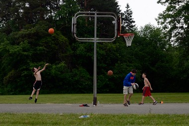 Chase Lakiness, 12, of Clarkston, left, shoots a basketball over the back of the hoop as he and his brother Tryston Lajiness, 13, center, play around taking shots from different distances with Cameron Finnegan, 11, of Linden on Sunday, June 9, 2013 at a court at Linden County Park in Linden.