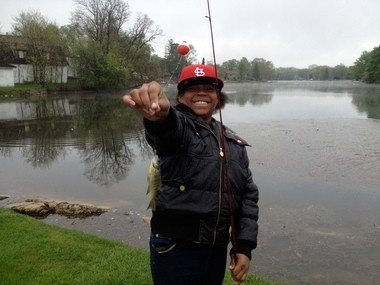 In this May 10 photo, a student hooks her first fish at an annual fishing field trip to Linden Mill Pond hosted by Rankin Elementary fourth-grade teacher Ben Anderson.