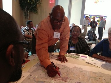 """Sylvester Jones draws the boundary for what his group thought should be the area of downtown Flint during the """"Imagine Flint"""" master plan land use workshop Tuesday, July 2, at the Flint Institute of Arts."""