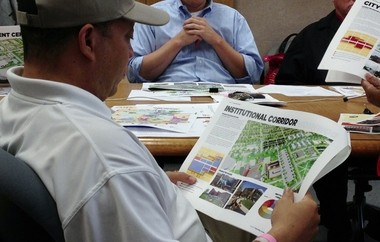 Sixth Ward Councilman Sheldon Neeley looks at a land use map while discussing the master plan during a committee meeting on Wednesday, July 31, at Flint City Hall.