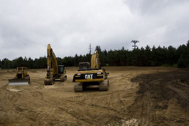 Construction equipment is parked on the grounds of the Karegnondi Water Authority pipeline at a June 28 groundbreaking ceremony in Fort Gratiot Township in this Flint Journal file photo.