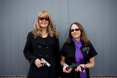 "Terri Franckowiak and Pam Pitlanish, members of ""The Well Armed Woman"" gun club hold their weapons on Wednesday afternoon, Nov. 20, 2013 outside the Sentinal Protection and Investigations shooting range on Fenton road in Flint."