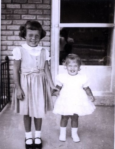 Paulette Jaster and her younger sister Pam are shown in this family photo.