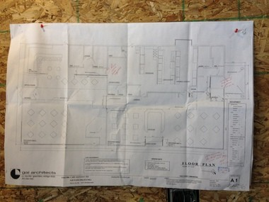 d216cfc37aabc A floor plan hangs on the wall as crew works on completing the new Flip  Flops