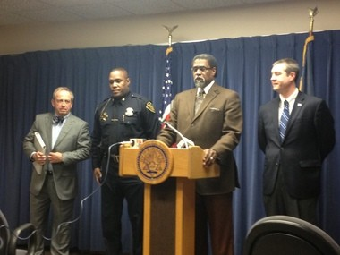 Flint Emergency Manager Darnell Earley is flanked by Mayor Dayne Walling, right, police Chief James Tolbert, left, and Max Chiddister, far left, Friday, Feb. 28, while announcing the creation of the Flint Police Foundation.