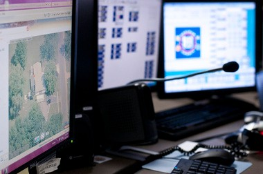 A former Genesee County 911 dispatcher has settled claims that she was fired from her job because she refused to quit singing in her band for $262,500.