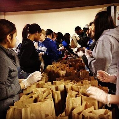Students pack lunches for homeless people at an event called #HashTagLunchBag at Flint Local. A student Blueberry Ambassador also included her Blueberry cards in a few of the bags.