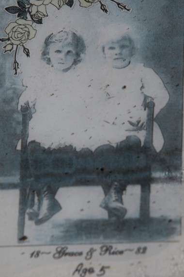 A photograph of Rice Custer Hagerman and Grace E. Hagerman sits on their head stone that marks their grave in Glenwood Cemetery in Flint on Sept. 9, 2014. The Hagerman twins, students of the Michigan School of the Deaf, were born on Sept. 19, 1877 and died within two days of each other in Dec. 1885 due to diphtheria. Laura McDermott | MLive.com