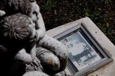 A picture lays on top of a head stone among an angel statue that marks the grave of Rice Custer Hagerman and Grace E. Hagerman in Glenwood Cemetery in Flint on Sept. 9, 2014. The Hagerman twins, students of the Michigan School of the Deaf, were born on Sept. 19, 1877 and died within two days of each other in Dec. 1885 due to diphtheria. Laura McDermott | MLive.com