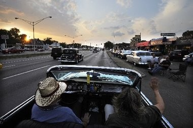 In this 2010 Associated Press file photo, Bill and Gloria Ewald of Troy cruise in their 1963 Buick Electra 225 in Royal Oak.