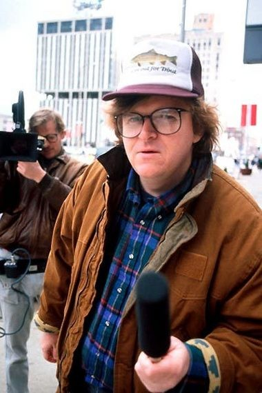 "In this undated handout image courtesy Warner Bros. and provided by the Library of Congress, Michael Moore, right, films ""Roger & Me"" in Flint in this Associated Press file photo."