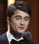 Daniel Radcliffe presents the Tony Award for Best Performance by an Actress in a Leading Role in a Play during the 65th annual Tony Awards, Sunday, June 12, 2011 in New York. (AP Photo/Jeff Christensen)