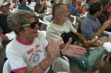 Darrell McKee (left), of Harrison Township, cheers with Richard Weston, of Birch Run, (center) and other 30-time Crim participants during the Crim Pep Rally and Celebrity Fashion Show in 2008. McKee is the oldest Crim racer to participate in all 10-mile races during the festival of races.