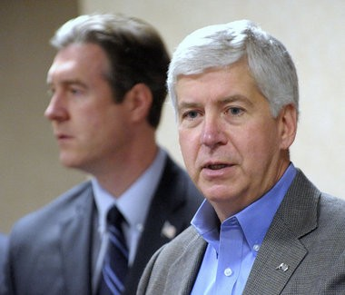 Gov. Rick Snyder announces support of the city of Flint's plan to switch back to Detroit water due to increasing lead levels during a news conference with Mayor Dayne Walling in Flint on Thursday Oct. 8, 2015